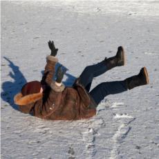 Fallen woman on slippery ice.